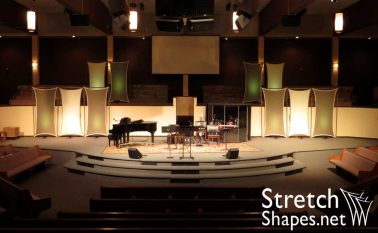 Multiple stretch fabric flat panel sails hung as stage backdrop for church stage design