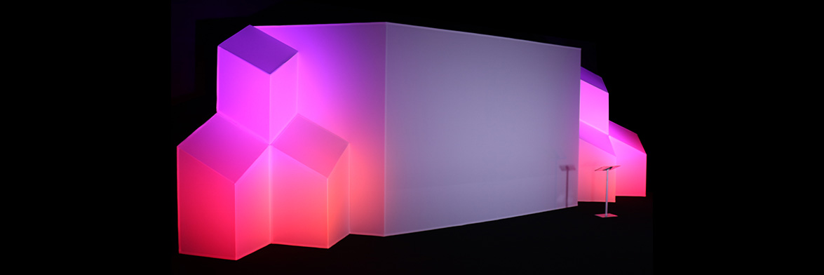 The Cubatron Junior projection mapping surface, with pink and purple lighting.