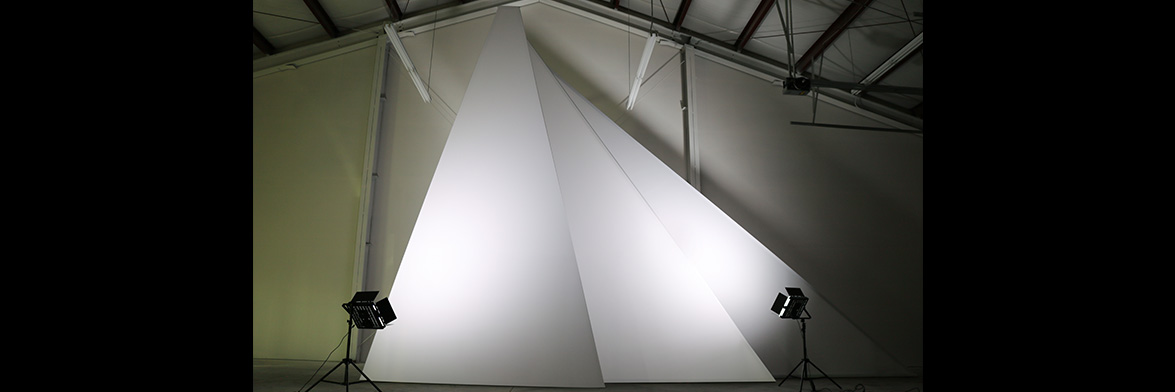 The Polygons, shown in our warehouse with white fabric and white lighting upon them.