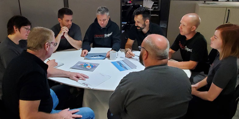 Step Two: Our Creative Design Team, consisting of 3D Modelers, Event Designers, Installers, Graphic Designers, and Relationship Managers discuss and design a customized solution