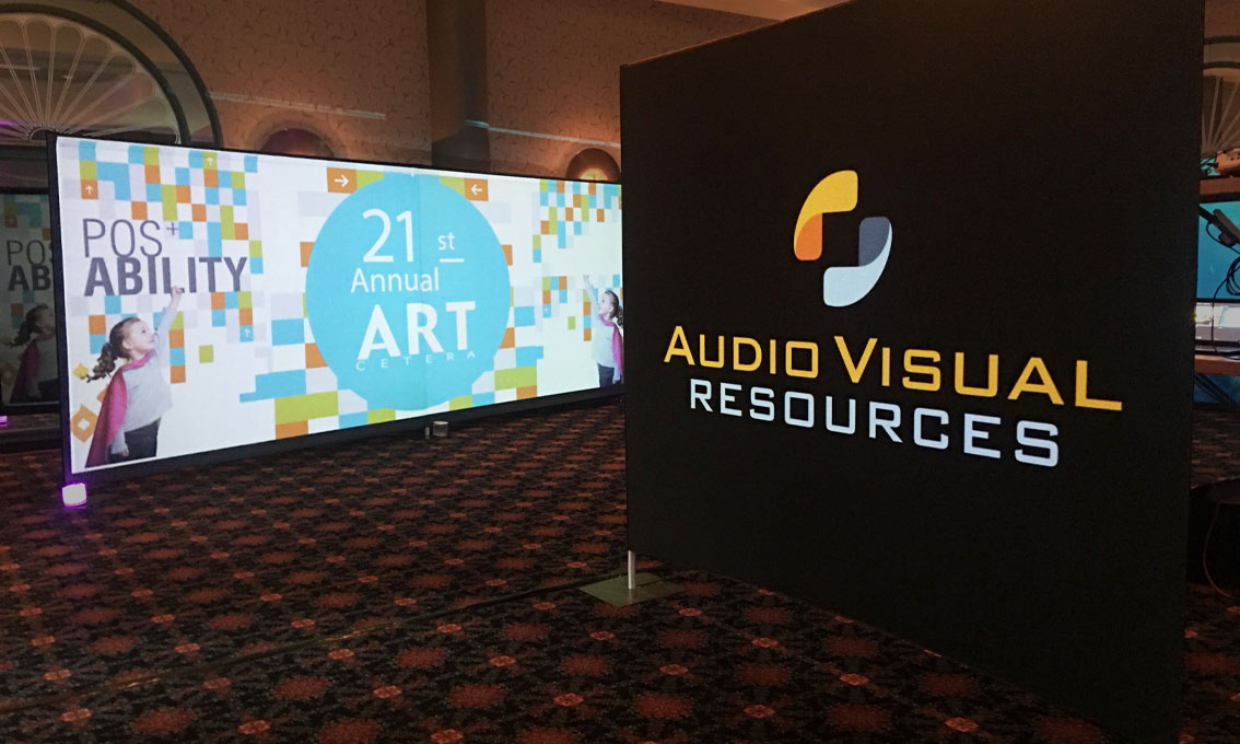 Printed Quick Walls for Audio Visual Resources and 21st Annual Art Cetera form a display at a trade show