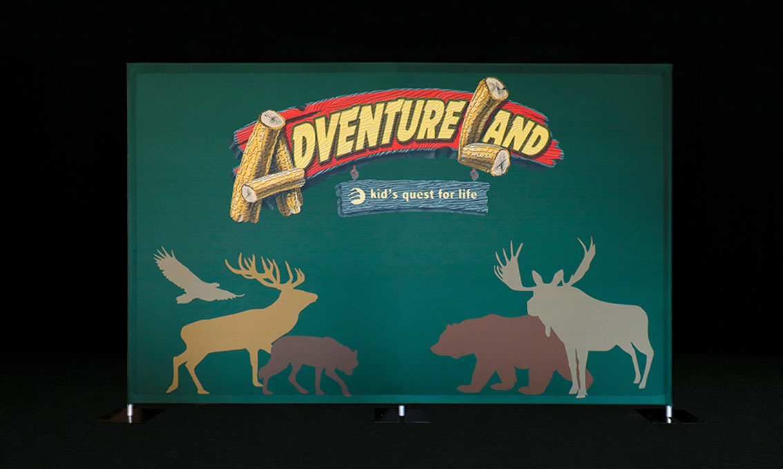 A colorful printed Quick Wall for Adventureland with wild animal silhouettes