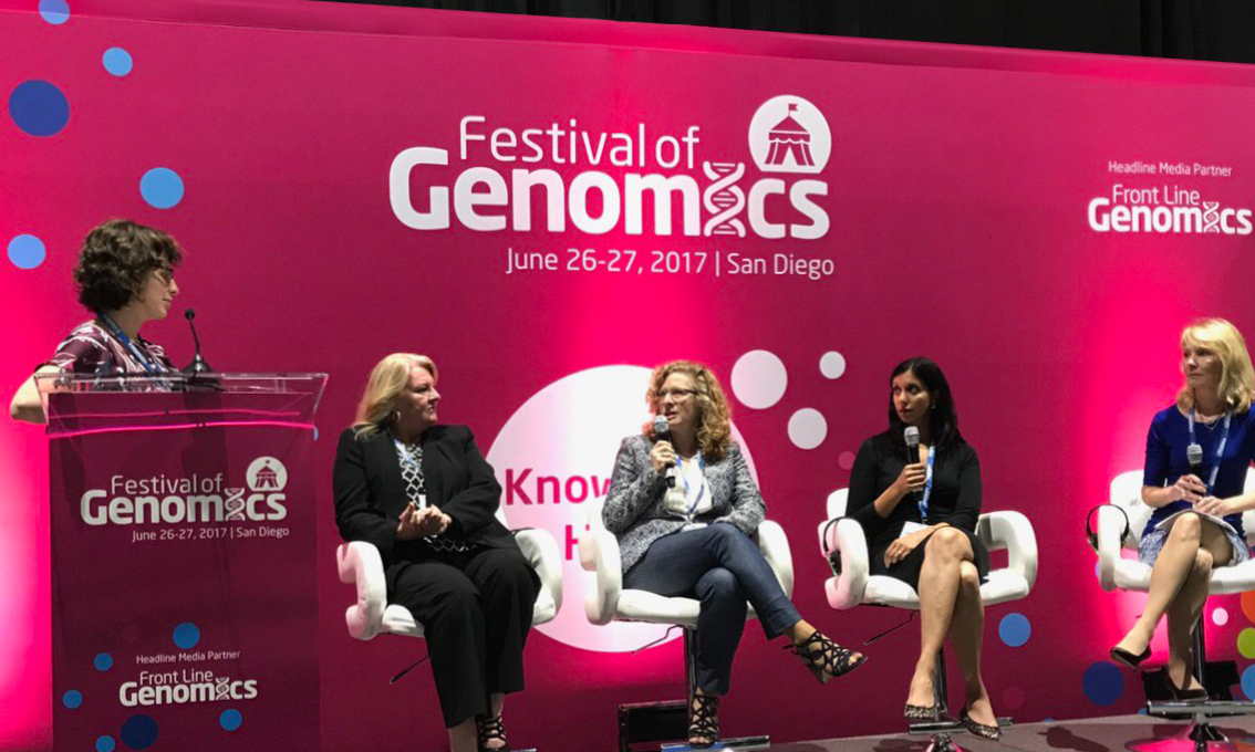 A bright pink printed Quick Wall for the Festival of Genomics