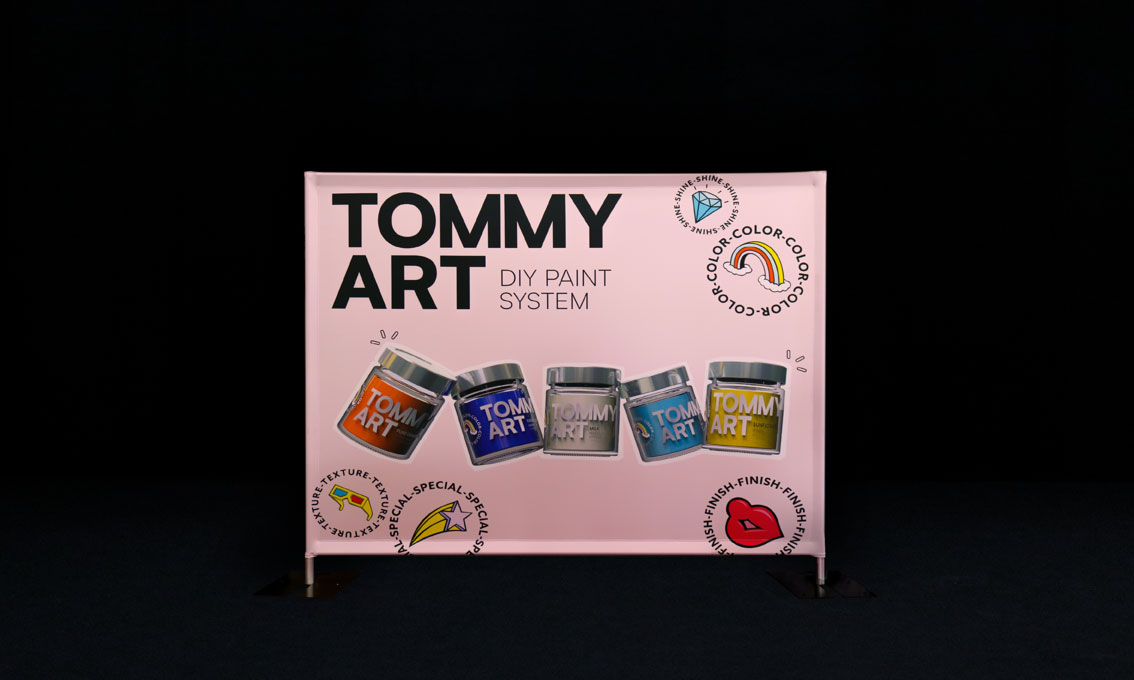 A printed Quick Wall for Tommy Art DIY Paint System with paint cans printed on it