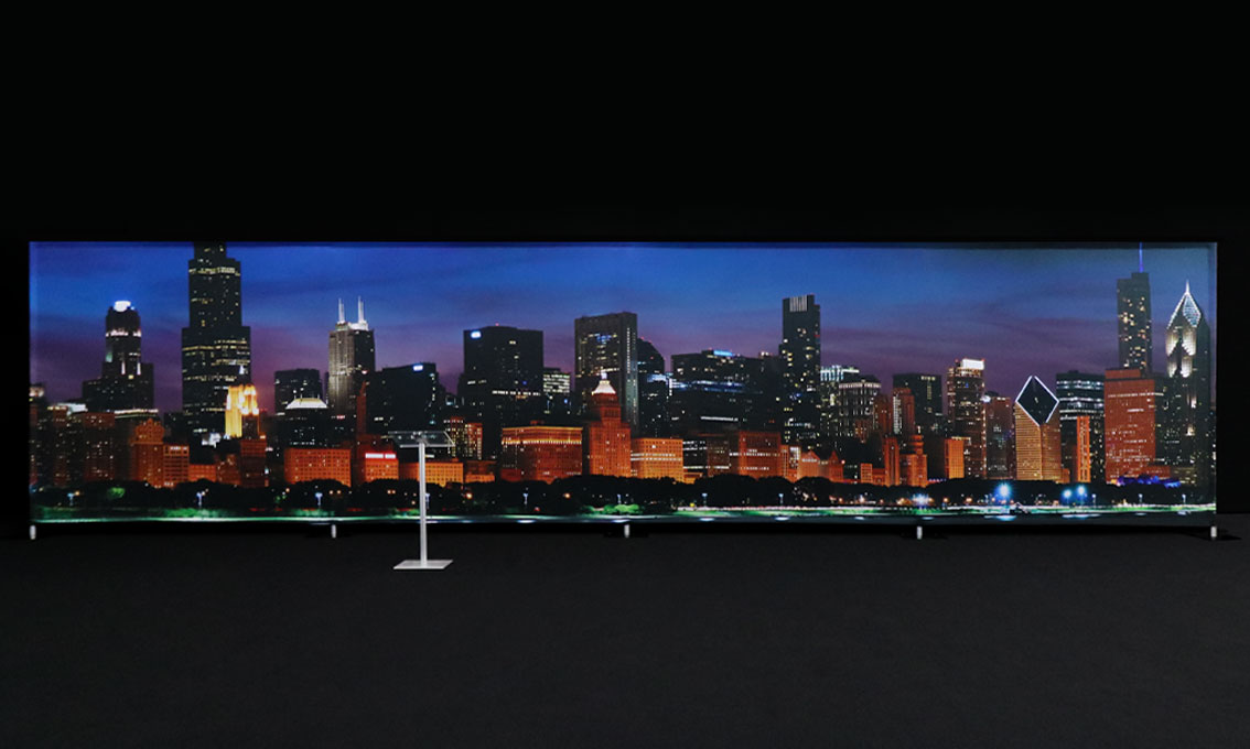 A long Quick Wall with the Chicago skyline printed on it