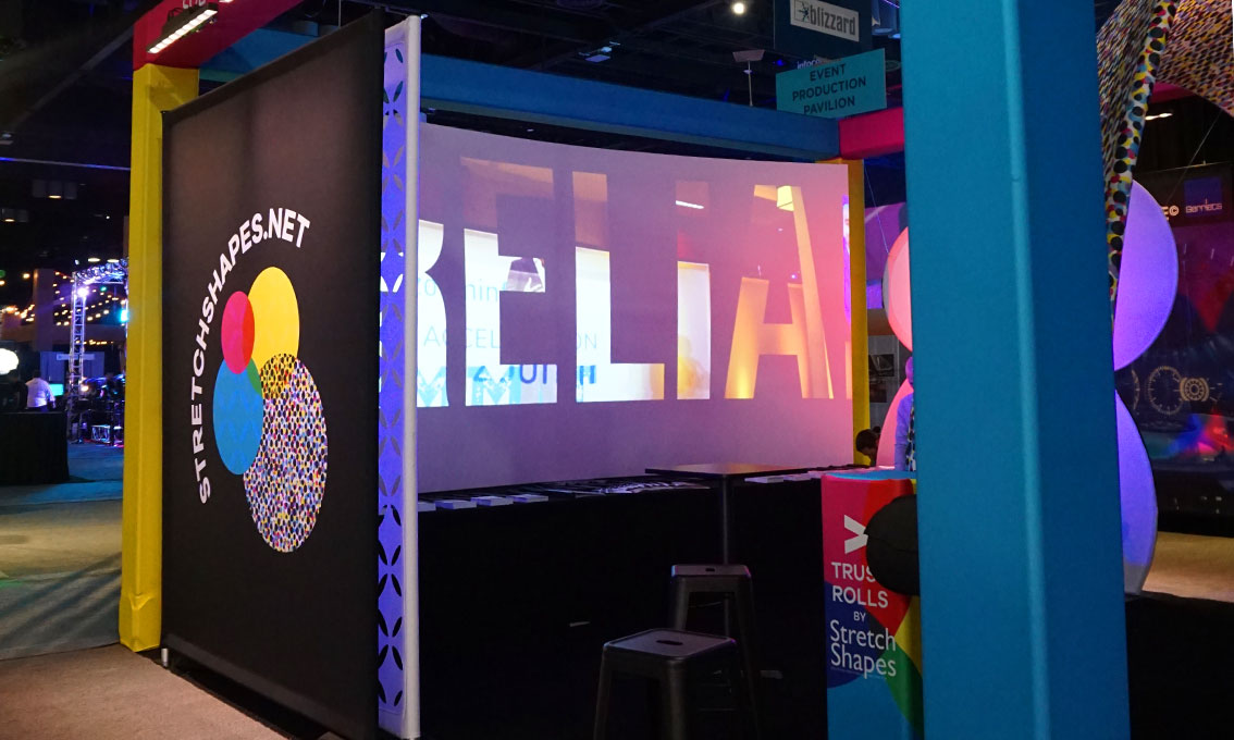 Stretch Shapes demos one of our own printed Quick Walls at InfoComm