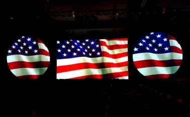 American flag projected on projection screens on big stage